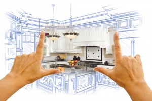Female Hands Framing Custom Kitchen Design Drawing and Photo Combination.